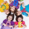 depositphotos_20752753-stock-photo-happy-school-kids-with-colorful